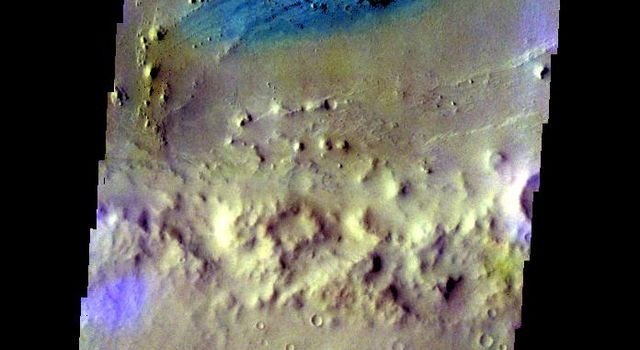 The THEMIS camera contains 5 filters. The data from different filters can be combined in multiple ways to create a false color image. This image from NASA's 2001 Mars Odyssey spacecraft shows part of the floor of Vernal Crater.