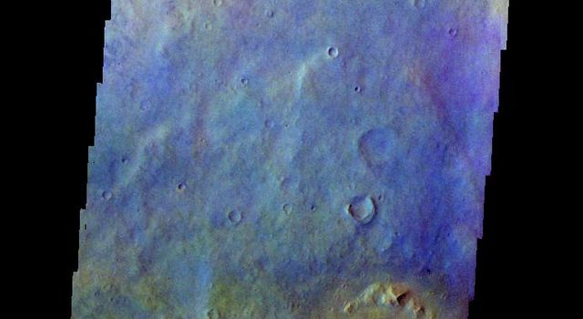 The THEMIS camera contains 5 filters. The data from different filters can be combined in multiple ways to create a false color image. This image from NASA's 2001 Mars Odyssey spacecraft shows part of the plains in Arabia Terra.