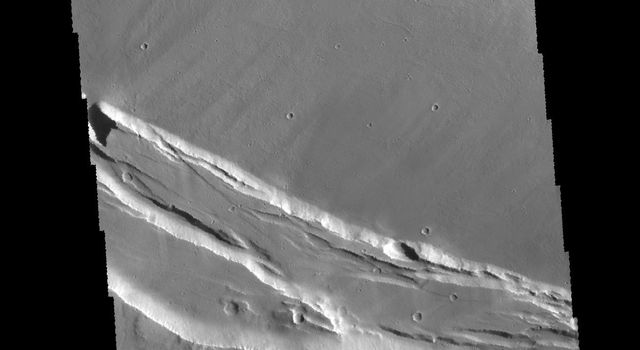 This image captured by NASA's 2001 Mars Odyssey spacecraft shows part of the summit caldera of Arsia Mons.