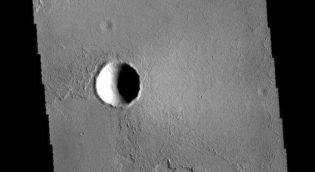 This image captured by NASA's 2001 Mars Odyssey spacecraft shows a small portion of the extensive lava flows of the Tharsis volcanic region.