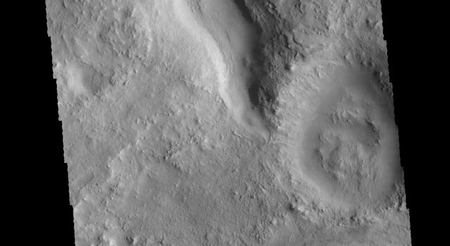 This image captured by NASA's 2001 Mars Odyssey spacecraft shows a short section of channel between two craters in Terra Sabaea.