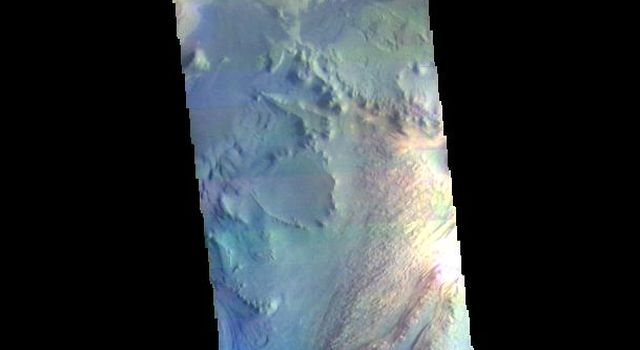 The THEMIS camera contains 5 filters. The data from different filters can be combined in multiple ways to create a false color image. This image from NASA's 2001 Mars Odyssey spacecraft shows part of Ganges Chasma.