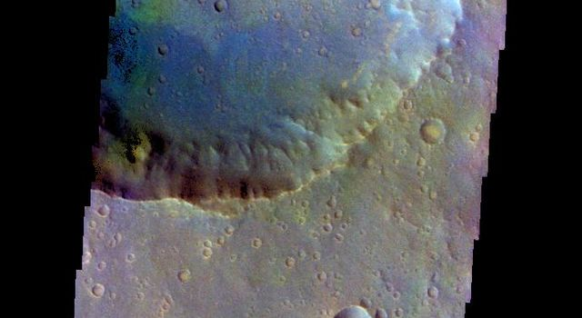 The THEMIS camera contains 5 filters. The data from different filters can be combined in multiple ways to create a false color image. This image from NASA's 2001 Mars Odyssey spacecraft shows part of Bamba Crater located in Xanthe Terra.