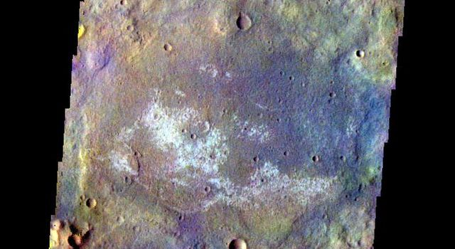 The THEMIS camera contains 5 filters. The data from different filters can be combined in multiple ways to create a false color image. This image from NASA's 2001 Mars Odyssey spacecraft shows some of the plains of Terra Cimmeria.