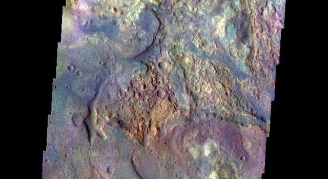 The THEMIS camera contains 5 filters. The data from different filters can be combined in multiple ways to create a false color image. This image from NASA's 2001 Mars Odyssey spacecraft shows some of the plains of Sabaea Terra.