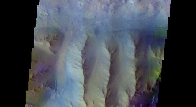 The THEMIS camera contains 5 filters. The data from different filters can be combined in multiple ways to create a false color image. This image from NASA's 2001 Mars Odyssey spacecraft shows part of Ius Chasma.