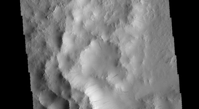 This image captured by NASA's 2001 Mars Odyssey spacecraft shows part of an unnamed crater in Arabia Terra.