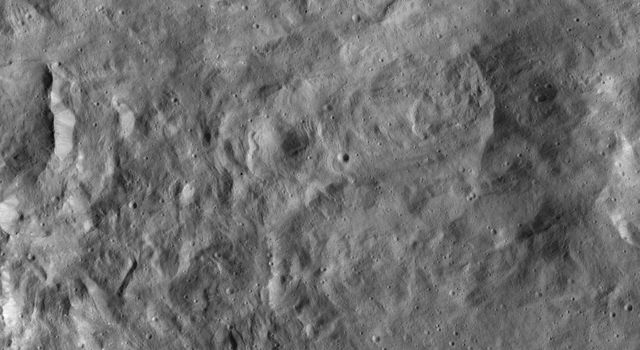 NASA's Dawn spacecraft imaged this terrain, adjacent to Occator Crater on Ceres, which is immediately to the left of this view. This relatively smooth, lightly cratered area is part of the ejecta blanket of Occator.