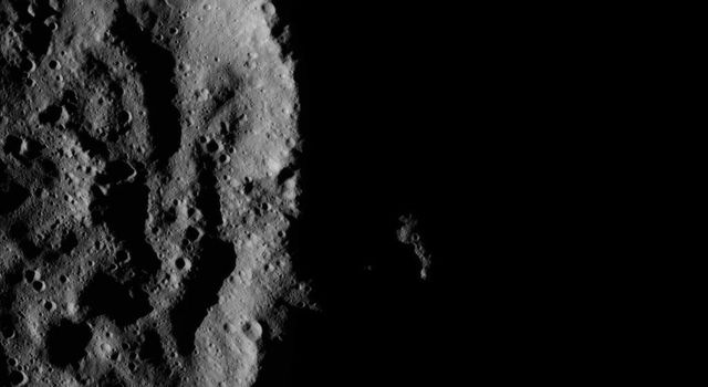 The rim of the crater blocks sunlight coming from the right, creating a moody scene on Ceres. NASA's Dawn spacecraft took this image on June 16, 2016.