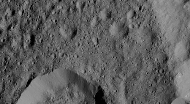 Liber Crater is featured at lower left in this image from Ceres. Named for the Roman god of agriculture, Liber is 14 miles (23 kilometers). NASA's Dawn spacecraft took this image on June 16, 2016.
