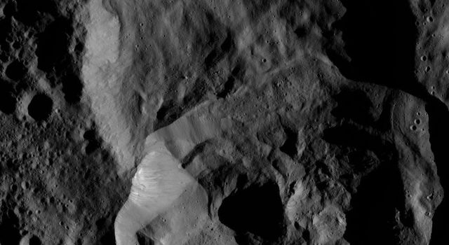 NASA's Dawn spacecraft took this image on Feb. 4, 2016, showing a double impact feature at high northern latitudes on Ceres, just south of the large crater named Ghanan.