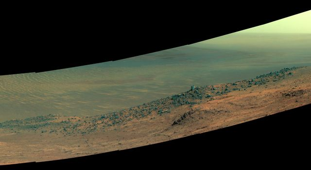 This enhanced color scene from NASA's Mars Exploration Rover Opportunity shows 'Wharton Ridge,' which forms part of the southern wall of 'Marathon Valley' on the western rim of Endeavour Crater.