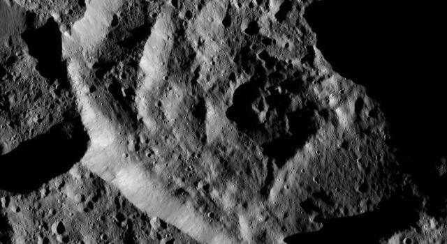 NASA's Dawn spacecraft took this image on June 7, 2016, showing a small crater within the larger southern hemisphere crater named Mondamin on Ceres.