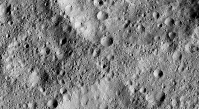 The scene shows a complex of craters in mid-southern latitudes on Ceres, just west of the peaks known as Niman Rupes. NASA's Dawn spacecraft took this image on June 15, 2016.