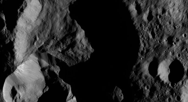 NASA's Dawn spacecraft captured this tortured landscape just south of Ghanan Crater on Ceres on May 28, 2016, at a distance of about 240 miles (385 kilometers) above the surface.