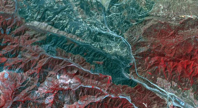 In San Bernardino County, California, the Blue Cut fire burned ferociously for one week starting Aug. 16, 2016. NASA's Terra spacecraft captured this image on Sept. 3, 2016. Healthy vegetation is depicted in red, with burnt areas in shades of black.