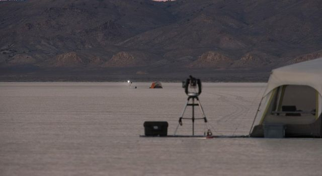 A test of a small-scale starshade model in a dry lake bed in central Nevada's Smith Creek by Northrup Grumman in May-June 2014. A telescope points toward a bright light, which mimics the conditions of starlight in space.