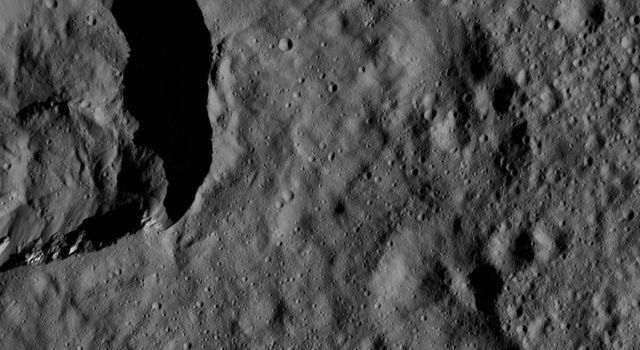 This view of Ceres from NASA's Dawn spacecraft, taken on May 29, 2016, features a small crater at upper left that adjoins Messor Crater.