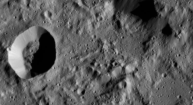 NASA's Dawn spacecraft captures part of the northern rim of Urvara Crater (101 miles, 163 kilometers wide). obtained on June 2, 2016, from its low-altitude mapping orbit, at a distance of about 240 miles (385 kilometers) above the surface.