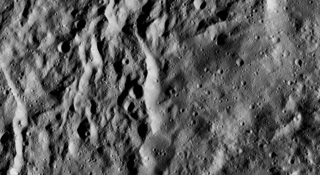 The interior of Urvara Crater (101 miles, 163 kilometers wide) is featured in this image from NASA's Dawn spacecraft taken on June 2, 2016 at a distance of about 240 miles (385 kilometers) above the surface.