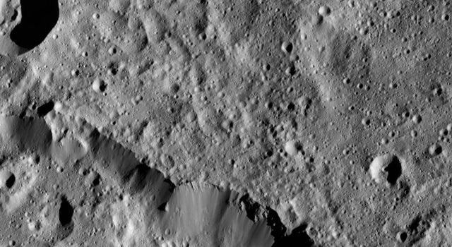 NASA's Dawn spacecraft views a portion of the northern rim of Urvara Crater (101 miles, 163 kilometers wide) in this scene from Ceres taken on June 3, 2016, at a distance of about 240 miles (385 kilometers) above the surface.