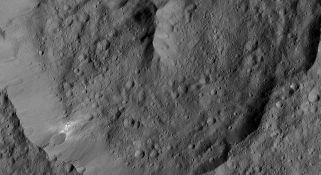 NASA's Dawn spacecraft spied Achita Crater on Ceres in this view captured on June 3, 2016, at a distance of about 240 miles (385 kilometers) above the surface. Achita is named for a Nigerian god of agriculture and is 25 miles (40 kilometers) wide.