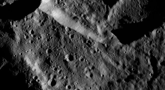 This image from NASA's Dawn spacecraft, taken on June 6, 2016, shows an area within the large crater Mondamin (78 miles, 126 kilometers wide) on Ceres.