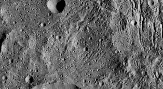 This image from NASA's Dawn spacecraft, taken June 7, 2016, shows part of Lono Crater (at bottom) within the giant Yalode impact basin on Ceres.