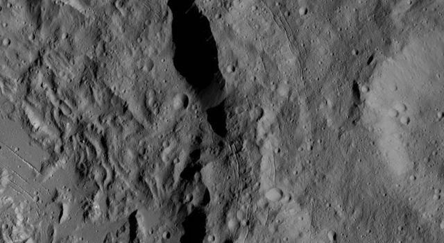 This image from NASA's Dawn spacecraft shows a portion of Ikapati Crater on Ceres. Dawn took this image on June 10, 2016, from its low-altitude mapping orbit, at a distance of about 240 miles (385 kilometers) above the surface.