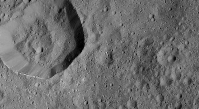 This image, taken on June 10, 2016 by NASA's Dawn spacecraft, shows cratered terrain on Ceres. Dawn took this image from its low-altitude mapping orbit, at a distance of about 240 miles (385 kilometers) above the surface.