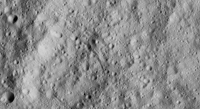 This image from NASA's Dawn spacecraft shows cratered terrain just south of the equator of Ceres. Dawn took this image on June 15, 2016, from its low-altitude mapping orbit, at a distance of about 240 miles (385 kilometers) above the surface.