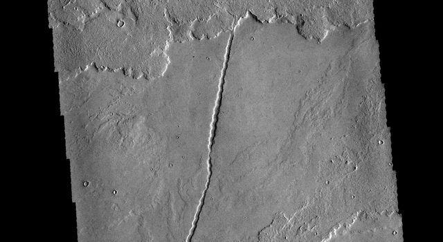 This image captured by NASA's 2001 Mars Odyssey spacecraft shows a very small portion of the extensive lava flows of the Tharsis volcanic complex.