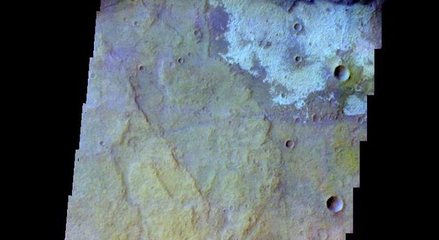 The THEMIS camera contains 5 filters. The data from different filters can be combined in multiple ways to create a false color image. This image from NASA's 2001 Mars Odyssey spacecraft shows part of the plains of Terra Sirenum.
