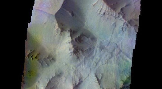 The THEMIS camera contains 5 filters. The data from different filters can be combined in multiple ways to create a false color image. This image from NASA's 2001 Mars Odyssey spacecraft shows part of Juventae Chasma.