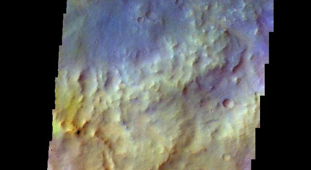 The THEMIS camera contains 5 filters. The data from different filters can be combined in multiple ways to create a false color image. This image from NASA's 2001 Mars Odyssey spacecraft shows part of the plains of Terra Cimmeria.