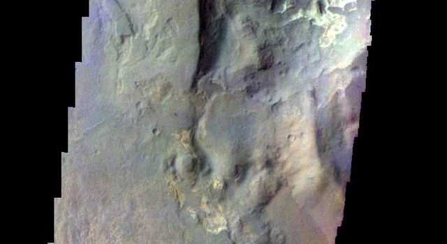 The THEMIS camera contains 5 filters. The data from different filters can be combined in multiple ways to create a false color image. This image from NASA's 2001 Mars Odyssey spacecraft shows part of Terby Crater.