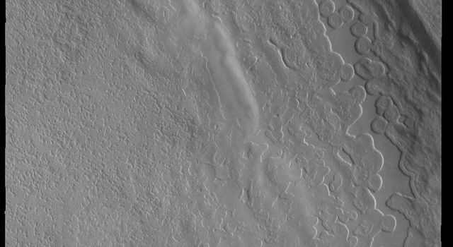 This image captured by NASA's 2001 Mars Odyssey spacecraft shows part of a depression (or trough) on the polar cap.