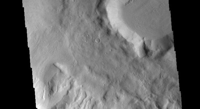 This image captured by NASA's 2001 Mars Odyssey spacecraft shows two craters in Terra Cimmeria.