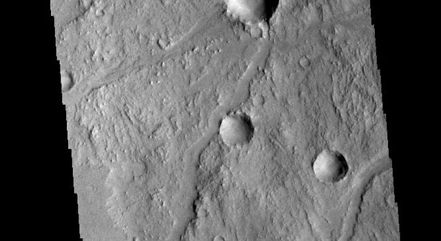 The linear depressions in this image from NASA's 2001 Mars Odyssey spacecraft are some of the numerous graben that make up Claritas Fossae.