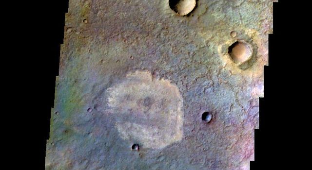 The THEMIS camera contains 5 filters. The data from different filters can be combined in multiple ways to create a false color image. This image from NASA's 2001 Mars Odyssey spacecraft shows part of the plains in Terra Sabaea.