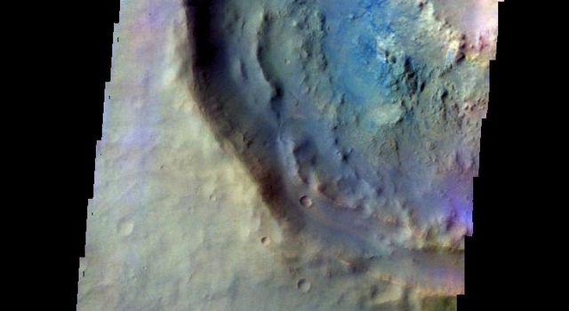 The THEMIS camera contains 5 filters. The data from different filters can be combined in multiple ways to create a false color image. This image from NASA's 2001 Mars Odyssey spacecraft shows part of a crater in Noachis Terra.
