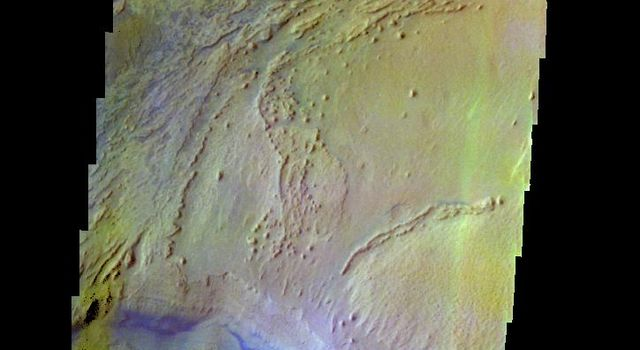 The THEMIS camera contains 5 filters. The data from different filters can be combined in multiple ways to create a false color image. This image from NASA's 2001 Mars Odyssey spacecraft shows part of the interior deposit of Firsoff Crater.