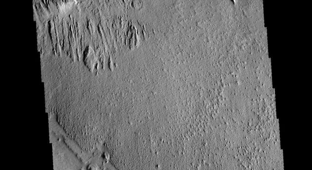 The elongated hills in this image from NASA's 2001 Mars Odyssey spacecraft are a feature termed yardangs.