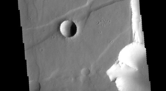 This image captured by NASA's 2001 Mars Odyssey spacecraft shows some of the graben which form Noctis Labyrinthus.