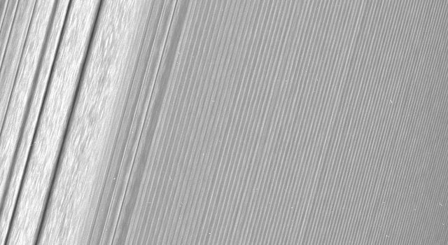 NASA's Cassini image features a density wave in Saturn's A ring (at left) that lies around 134,500 km from Saturn. Density waves are accumulations of particles at certain distances from the planet.