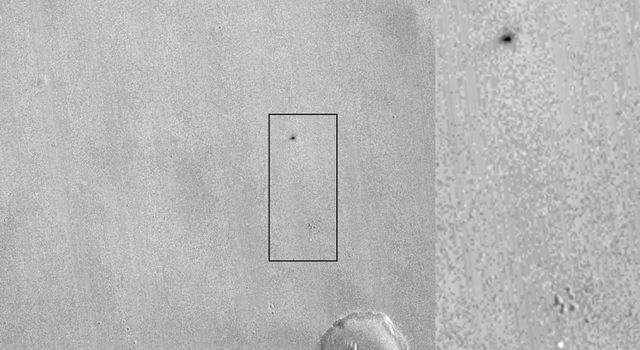 This image from NASA's Mars Reconnaissance Orbiter shows one of two spots that likely appeared in connection with the Oct. 19, 2016, arrival of ESA's Schiaparelli test lander. An animation is available at the Photojournal.