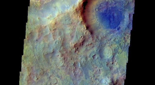 The THEMIS camera contains 5 filters. The data from different filters can be combined in multiple ways to create a false color image. This image from NASA's 2001 Mars Odyssey spacecraft shows part of Terra Sabaea.