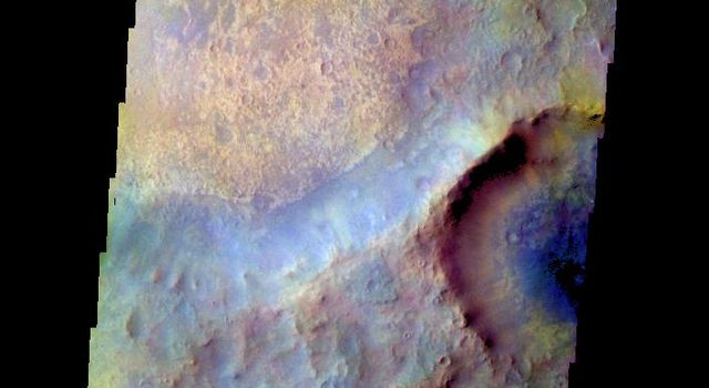 The THEMIS camera contains 5 filters. The data from different filters can be combined in multiple ways to create a false color image. This image from NASA's 2001 Mars Odyssey spacecraft shows part of Syrtis Major Planum.