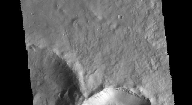 This image captured by NASA's 2001 Mars Odyssey spacecraft is located in Noachis Terra. The unnamed crater at the bottom of the image contains a central pit.