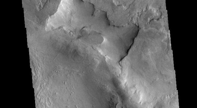 This image captured by NASA's 2001 Mars Odyssey spacecraft shows part of two unnamed craters in Noachis Terra.
